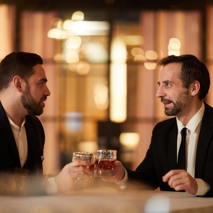 Two Business People Celebrating in Restaurant